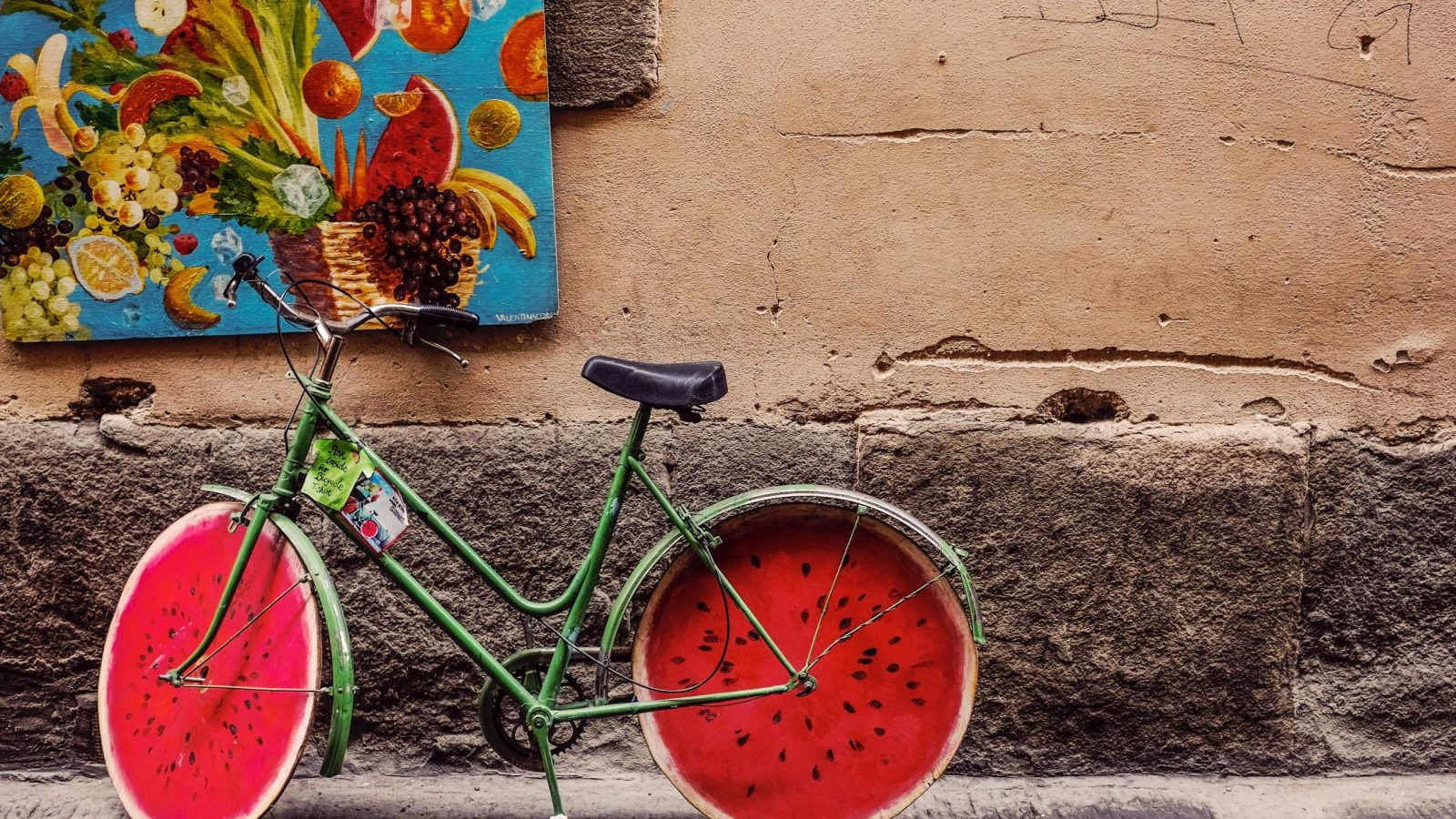 Colored bike against a wall in Florence