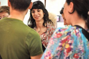 Beginner students mingling during a course break