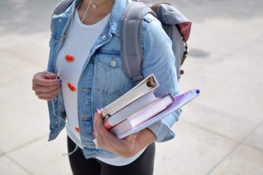 Student going to italian private lessons with books
