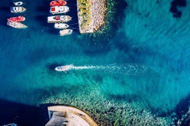 boat entering elba's port