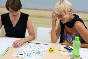 two women studying italian